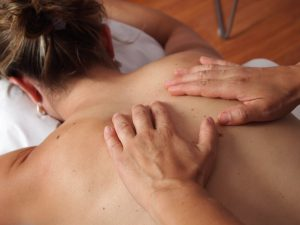Photo of someone receiving a massage to help with the effects of over training