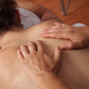 Massage Therapy - person receiving massage