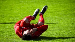 Soccer player laying on field in pain