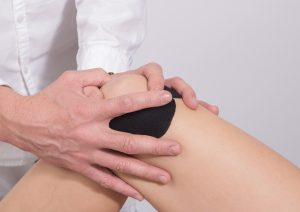 Athlete getting a knee assessment