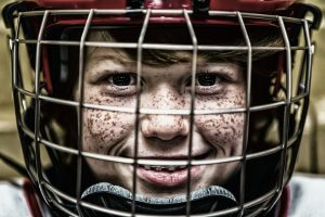 Freckled kid in helmet