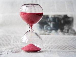 hour glass with red sand