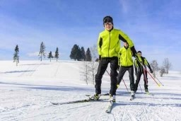 3 People cross country skiing