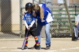 Kid learning how to bat