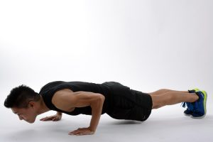 Man doing a plank in push-up position