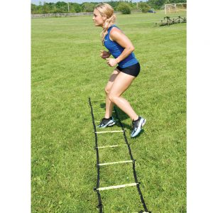 Women using agility ladder