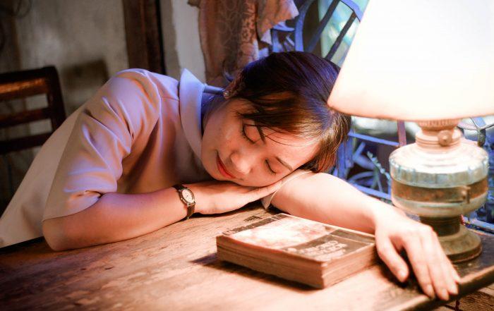 Girl sleeping while sitting at desk